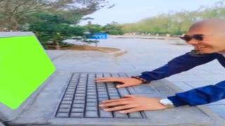 egg man typing on stone laptop green screen