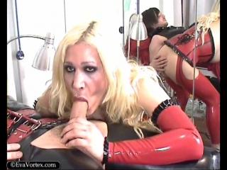 Eva Vortex - Red Rubber Nurse [Tattooed Shemale]