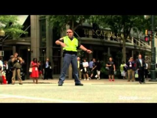 US Election 2012: Dancing police officer entertains drivers at Democratic National Convention